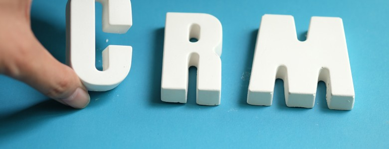 Hand arrange white letters as CRM