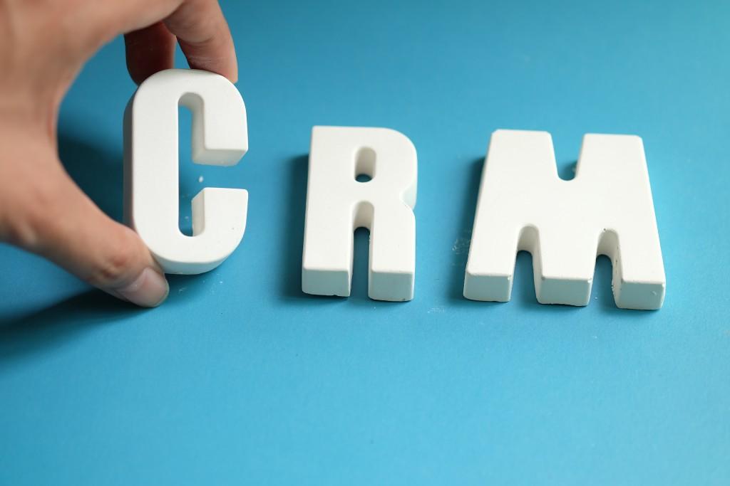Hand arrange white letters as CRM